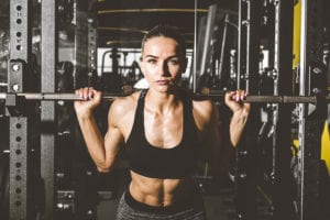 how should woman train in the gym?